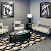 Framed photographsin the lobbyof Smith, Rolfes & Skavdal law firm's Sarasota, FL office