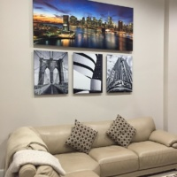 A collection of high-definition metal prints of iconic New York landmarks paired with an 80 inch skyline.